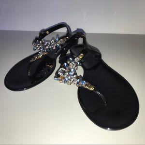 Cupid Black thong sandal.